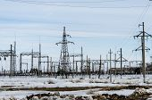 stock photo of transmission lines  - Power transmission line and constructions in winter - JPG