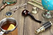 stock photo of spyglass  - Traveler Wood Table With Many Necessary Items - JPG