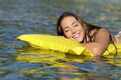image of bathing  - Happy girl bathing on the beach in summer vacation smiling with perfect teeth on a yellow mattress - JPG