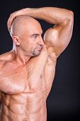 stock photo of bodybuilder  - Bodybuilder is posing showing his muscles - JPG