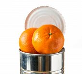 image of satsuma  - Orange tangerine or satsuma fruit heaped inside opened tin can container in concept of fresh food coming in cans - JPG