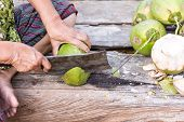 stock photo of knife  - Coconut chopped with a knife beautiful view - JPG