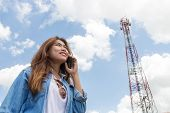 picture of freedom tower  - Beauty Women Use Smart Phone Call And Satellite Communication Tower Background - JPG