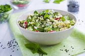 stock photo of tabouleh  - Close up of a healthy grain and vegetable salad - JPG