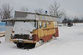 stock photo of camper  - camper covered by  snow in winter on a cloudy day - JPG