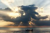 picture of boat  - Sunrise, traveling to Kenya, the people in the boat, the boat in the ocean, beginning of the day, ** Note: Visible grain at 100%, best at smaller sizes - JPG