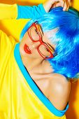 image of wig  - Bright glamorous girl in vivid clothes and a wig alluring over yellow background - JPG