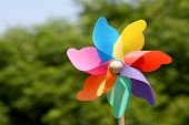 image of wind wheel  - childs toy pin wheel in windy weather - JPG