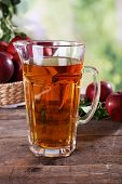 picture of jug  - Full jug of apple juice and fruits on bright background - JPG