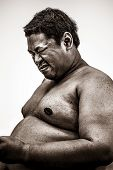 picture of body fat  - Fat naked upper body and stomach of an African tribal man showing pain expression on his face in white isolated background in heavy grain grunge style - JPG