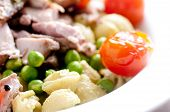 foto of thighs  - chicken thighs with pea pesto pasta and tomatoes - JPG