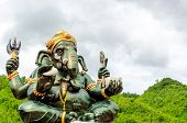 pic of hindu  - Green Ganesha Hindu God statue close up on natural background - JPG
