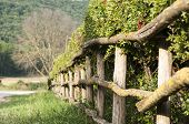 stock photo of wooden fence  - wooden fence with a fence in the countryside - JPG