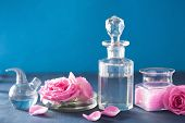 stock photo of flask  - alchemy and aromatherapy with rose flowers and chemical flasks - JPG