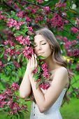 foto of allergies  - Young spring fashion woman in spring garden Springtime Summertime Trendy girl in the flowering trees in then at sunset in spring summer landscape background Allergic to pollen of flowers Allergy 