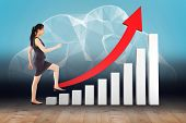 foto of step-up  - Businesswoman stepping up against cloud computing in room - JPG