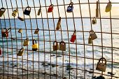 foto of loyalty  - Rusty love locks hanging on the fence as a symbol of loyalty and eternal love - JPG