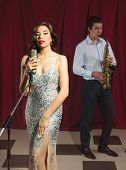 pic of singer  - Female singer and saxophonist performing at the jazz club - JPG