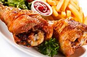 image of thighs  - Grilled turkey thighs with chips and vegetables  - JPG
