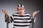 pic of prison uniform  - Funny prisoner in chains isolated on gray - JPG