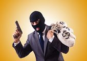 stock photo of gangster  - Gangster with bags of money against the gradient - JPG