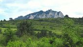picture of pieniny  - Tri koruny mountain in Pieniny national park behind the green hills - JPG