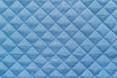 picture of quilt  - blue quilted synthetic fabric with grained texture for empty and pure abstract backgrounds - JPG