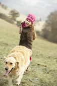 picture of country girl  - Girl on country walk with dog in winter - JPG