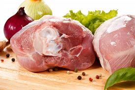 image of turkey-hen  - Raw turkey legs on cutting board  - JPG