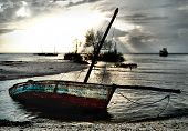 Red White Blue Dhow Sailing Boat Stranded At Low Tide In Ocean Mozambique