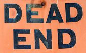A Dirty Grungy Orange Dead End Sign