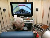 stock photo of video game  - The man sits and plays a computer game - JPG