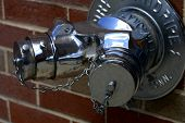 foto of firehose  - Closeup of a chrome dry standpipe connection - JPG