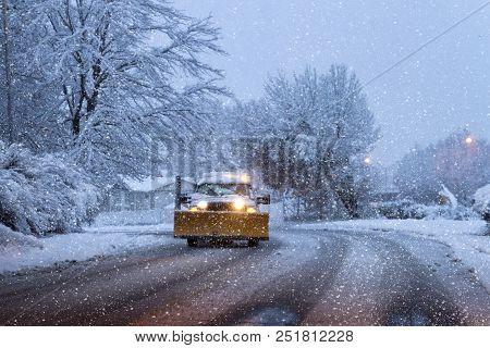 Snow Plow On A Snowy