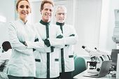 New Discovery. Biotechnologists Wearing White Laboratory Uniform Feeling Very Busy While Planning Ne poster