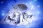 picture of archangel  - a dreaming angel over blue christmas background - JPG