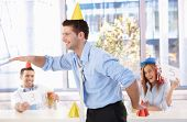 Young businessman having fun at office party, laughing.?