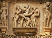 stock photo of kamasutra  - a sex act depicted in temple of khajuraho - JPG