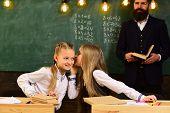 Gossip Whispering, Little Girls Whispering Gossip At School Lesson. Gossip Whispering Of Two Girls F poster