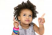 Close-up Portrait Of Cute Little Child Looking And Pointing With Fingers. Lovely Dark Curly Hair. Sw poster