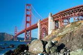The Golden Gate Bridge In San Francisco With Rocks