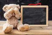 Teddy Bear Covering Eyes And A Blank Blackboard, Space For Text poster