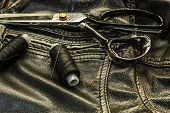 Sewing Leather Jacket, Repair Of Leather Jacket Scissors, Thread, Close-up. Products Of Leather. poster