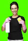 portrait of a middle aged woman cleaning against a removable chroma key background