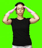 portrait of a middle aged woman tired against a removable chroma key background