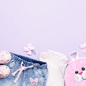 Little Girl Clothes Collection Flat Lay With T-shirt, Jeans, Sandals, Backpack On Pastel Background. poster