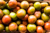 Boxes Of Bright Tomatoes Ready For Sale At A Farmers Market poster