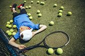 Top View Full Length Calm Boy Relaxing On Court While Keeping Racket poster