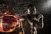 Determined And Confident Boxer With Fiery Boxing Gloves poster