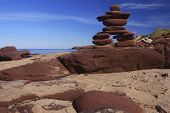 Inukshuk Made Of Red Rocks